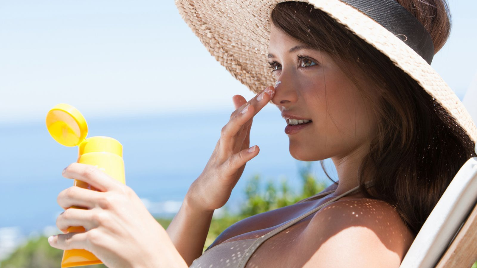 Image result for sun protection picture of girl applying sunblock